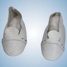 Pair of White Leather Shoes a Hard Plastic Doll.