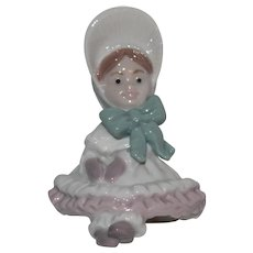 Marked Lladro 1995 Porcelain Christmas Doll Ornament.