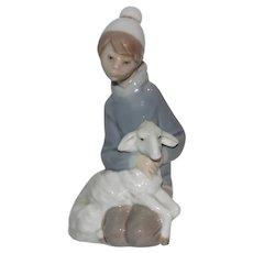 Lladro Porcelain Shepherd Boy Kneeling with Lamb Figurine.