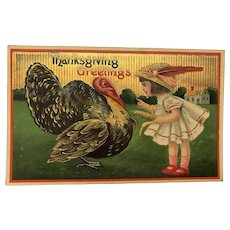 Girl holding Corn Cob for Turkey - Thanksgiving Gold Embossed German Postcard