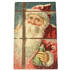 1907 TUCK & Sons Santa with Doll, Looking through the Window Postcard