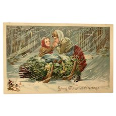 TUCK Christmas Postcard - Mother and Child with Pine Branches on Sled