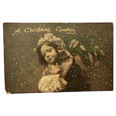 1910 German Tinted Real Photo Christmas Postcard – Little Girl with Muff