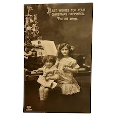 German Real Photo Christmas Postcard – Two Children Sitting at Piano