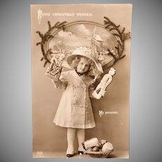 1913 Schwerdtleger [Berlin] Girl with Presents Real Photo Postcard