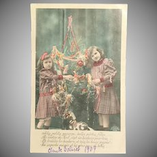 1909 Real Photo French Tinted Postcard – Two Girls Decorating Christmas Tree