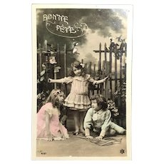 """c. 1900 Real Photo French Tinted Postcard – Three Young Children with Kite - """"Bonne Fête"""""""
