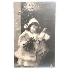 "1913 Real Photo Postcard - Girl with Umbrella and Packages - ""Gelukkig Nieuwjaar"""