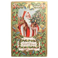 "c. 1900 Embossed German Postcard - Santa Holding Gifts and Decorated Tree - ""Joyful Xmas"""
