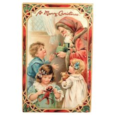 1910 TUCK'S Embossed Postcard - Santa Handing Gifts to Children - The Santa Claus Series