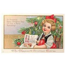 c. 1900 J.E.P. Embossed Postcard - Little Girl Singing a Christmas Carol by Christmas Tree