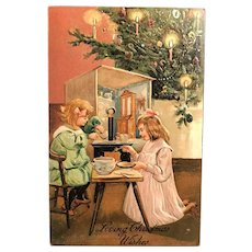 c. 1900 German Embossed Postcard – Little Girls Having a 'Tea Party' at Christmas Tree