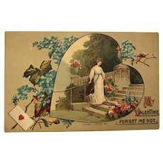 1910 Victorian Lady Standing on Stairs with Forget-Me-Not Flowers Valentine Postcard