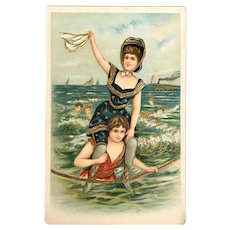 German A.B.S. Gold Embossed Two Women Playing in the Sea Postcard
