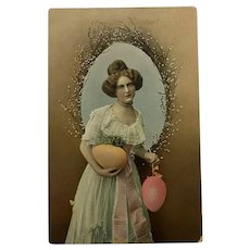 c.1900 Real Photo Postcard with Lady Holding Large Yellow and Pink Eggs