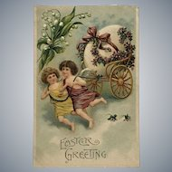 c.1900 Two Little Angels Pulling Large Egg on Cart with Ribbon and Flowers Easter Postcard
