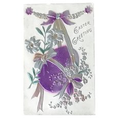c. 1900 Easter Egg Held with Ribbons, Adorned with Lilies Embossed Easter Postcard