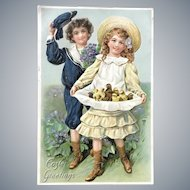 c. 1900 TUCK's Easter Series Postcard with Young Boy and Girl Holding Baby Chicks