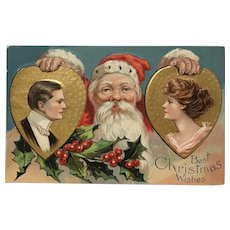 Santa Holding Two Gold Hearts with Man / Woman Profiles Postcard
