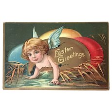 """c 1900 """"Easter Greetings"""" Angel w/Blue Wings Crawling out of Cracked Easter Egg"""