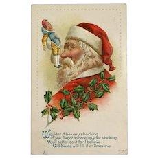 1917 Santa Holding Up Little Elf Doll