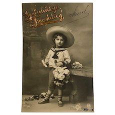 "1912 Real Photo of Child in Sailor Suit ""Gelukkige Feestdag"" Gold Applique"