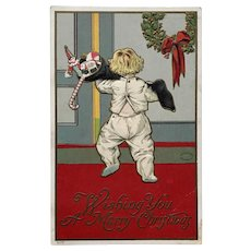 1908 Julius Bien Child in PJ's Carrying Black Stocking Filled with Toys Christmas Postcard