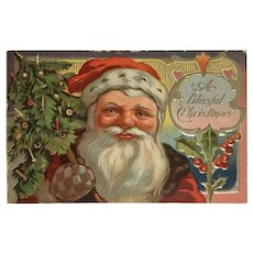 Santa Holding Little Tree with Checkered Glove Christmas Postcard