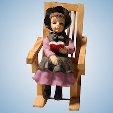 Dollhouse Girl in Rocking Chair Reading Book