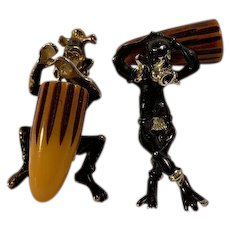 Pair of Mid-Century Painted Metal and Bakelite Blackamoor Pins by Charles Worth