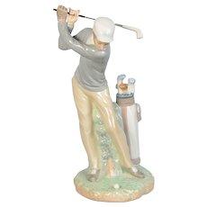 Lladro Golfer Set to Swing at the Ball Figurine