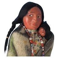 Skookum Squaw with Baby Under Wraps