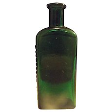Vintage Green Moone's Emerald Oil Rochester New York Bottle