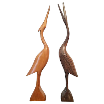 Herons - two wooden statues