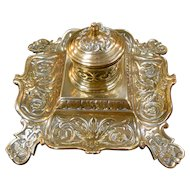 Beautiful antique English Victorian brass inkstand and original porcelain inkwell liner.