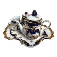 Bachelor-blue, white floral and gold tea set made in china-1990-2005
