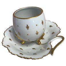 Porcelain cup and saucer set-French limoges -the Fleur de lys.-circa -1900s