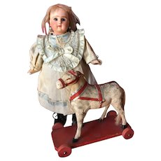 Old Doll Pull Toy Horse on Wood Plank with Wheels