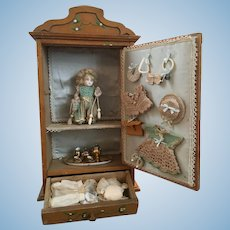Adorable French wardrobe with German all bisque doll and her trousseau