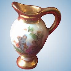 French Limoges old porcelain pitcher ornate with characters and flowers - Doll size-