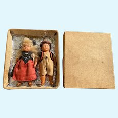 Lovely pair of German celluloid folk dolls with Swiss costumes