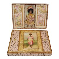 Endearing French SFBJ black Lilliputian with her trousseau in a lovely box