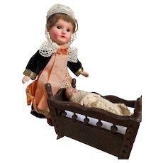 Endearing clay baby doll in an antique wooden baby cradle from Brittany and his mommy!