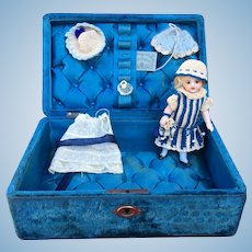 Rare all bisque German S & H  mold 939 doll in an antique presentation box with trousseau and accessories