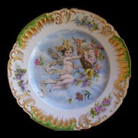 Incredible Limoges Fancy Presentation Charger; Winged Cherub; Basket of Flowers; Inscribed in Gold on the Reverse