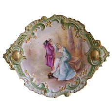 """Exquisite Large Limoges Rococo Charger/Plaque with Ornate Border Featuring Raised Gold Embellishments and Handles with Gold Medallions and Raised Gold Paste Flowers; With a Central Cartouche of a Courtship Scene in a Forest; Artist Signed """"HENRY"""""""