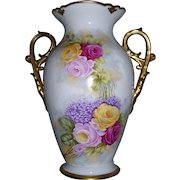 """Tressemann & Vogt Limoges Vase with Large, Scrolled and Gilded Handles Decorated in the Roses and Lilac Pattern; Artist Signed """"Rousset"""""""