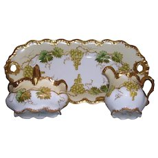 Rare and Unusual Limoges France Creamer, Sugar Basket and Tray Decorated With Green Grapes and Leaves Outlined in Raised Gold Paste on Raised Gold Paste Tendrils and Branches; Richly Gilded Handles and Borders on All of the Pieces
