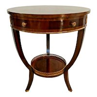 Maitland-Smith Round Table with Drawer and bottom shelf Flame Mahogany