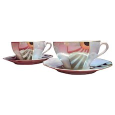 Limoges luster deco cups and saucers signed with iridescent glaze and gilding